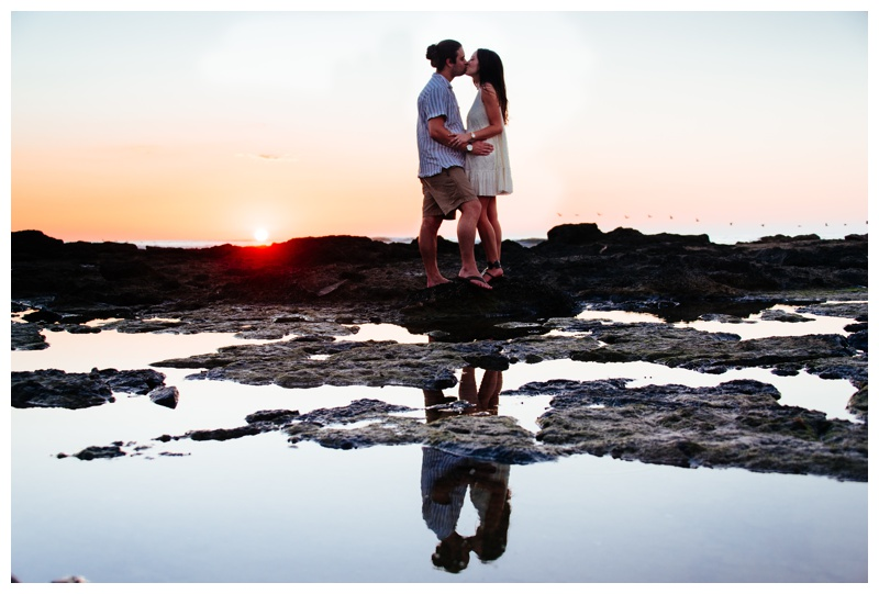 Reflections in a low tide pool of a couple kissing during sunset in Costa Rica. Photographed by Kristen M. Brown, Samba to the Sea Photography.