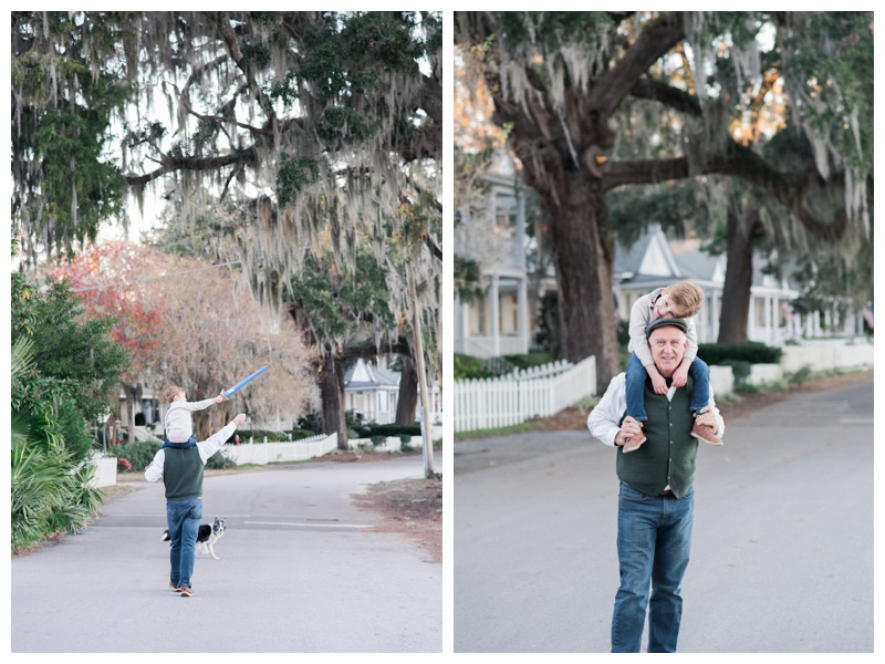 Grandfather walking with grandson on his shoulders during family photos in Isle of Hope, GA. Photographed by Kristen M. Brown, Samba to the Sea Photography.