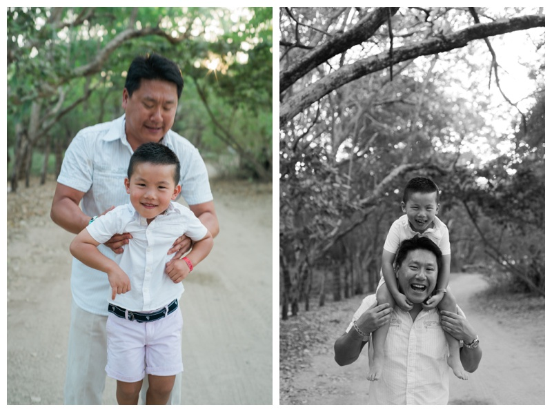 Father with his young son on his shoulders. Photographed by Kristen M. Brown, Samba to the Sea Photography.