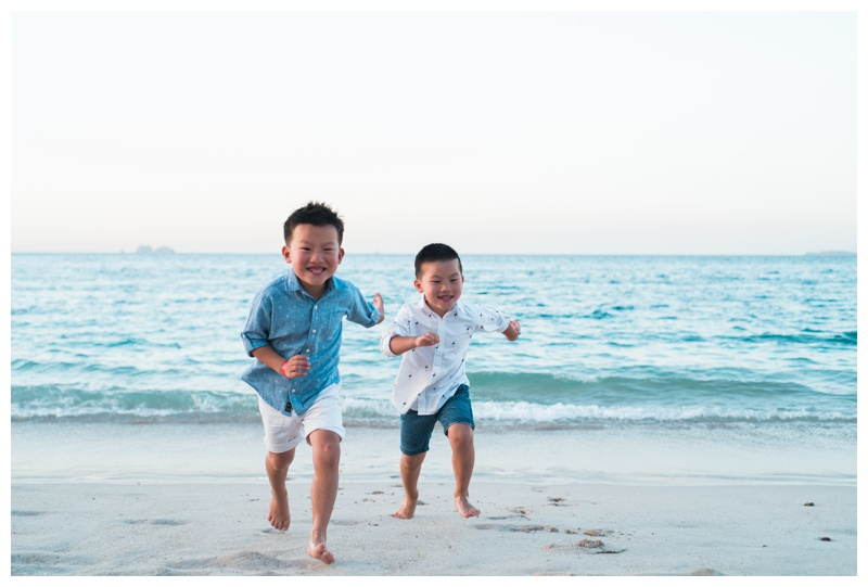 Young brothers running on the beach in Playa Conchal, Costa Rica. Photographed by Kristen M. Brown, Samba to the Sea Photography.
