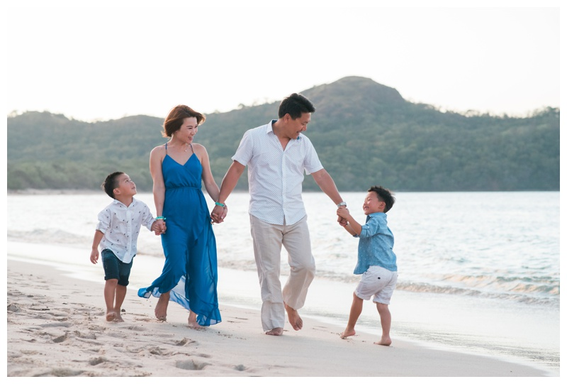 Family walking down the beach in Playa Conchal, Costa Rica. Photographed by Kristen M. Brown, Samba to the Sea Photography.