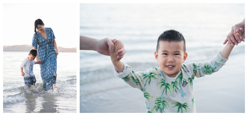 Young boy playing with his mom on the beach during family photos in Costa Rica. Photographed by Kristen M. Brown, Samba to the Sea Photography.