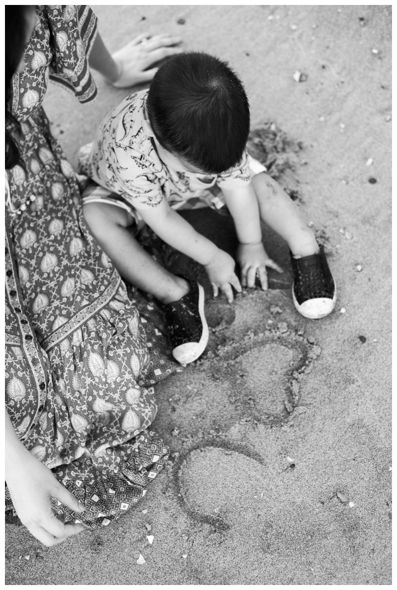Young boy playing in the sand in Costa Rica. Photographed by Kristen M. Brown, Samba to the Sea Photography.