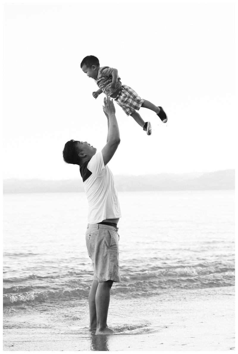 Father tossing his young son in the air during family photos at the Andaz Papagayo. Photographed by Kristen M. Brown, Samba to the Sea Photography.
