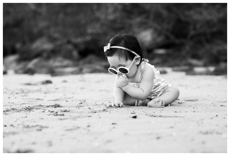Baby tasting sand for the first time at the beach in Costa Rica. Photographed by Kristen M. Brown, Samba to the Sea Photography.