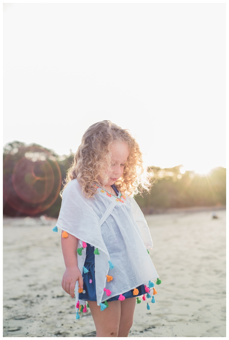 Portrait of a young girl on the beach in Tamarindo, Costa Rica. Photographed by Kristen M. Brown, Samba to the Sea Photography.