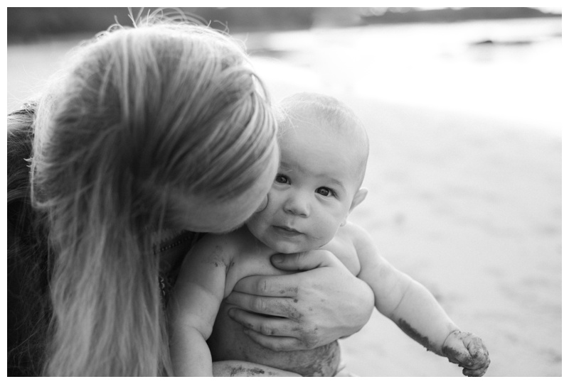 Mom kissing her baby boy's cheek during family photos in Tamarindo, Costa Rica. Photographed by Kristen M. Brown, Samba to the Sea Photography.