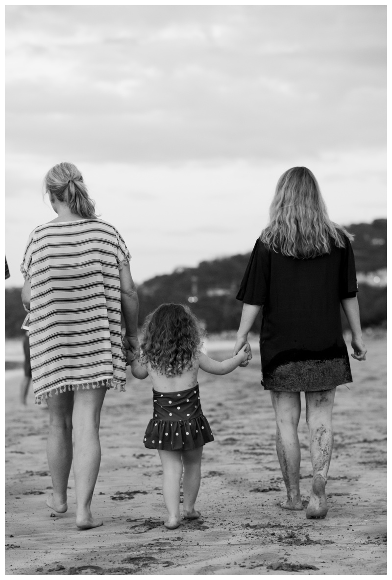 Three generations of women walking on the beach in Tamarindo, Costa Rica. Photographed by Kristen M. Brown, Samba to the Sea Photography.