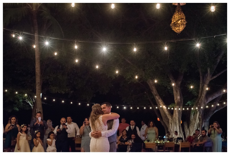 First dance under string lights at Pangas Beach Club in Tamarindo, Costa Rica. Photographed by Kristen M. Brown, Samba to the Sea Photography.