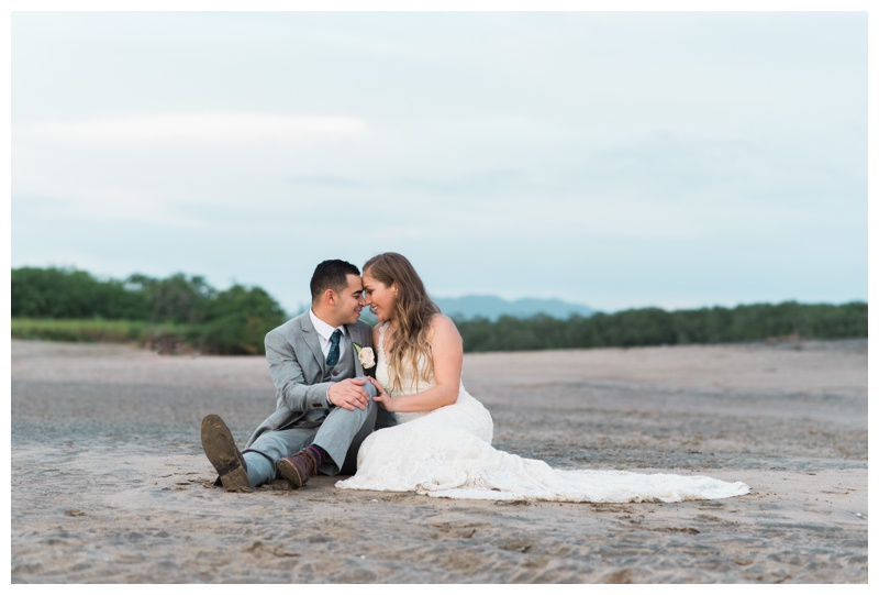 Bride and groom sharing a beautiful moment on the beach in Tamarindo, Costa Rica.Photographed by Kristen M. Brown, Samba to the Sea Photography.