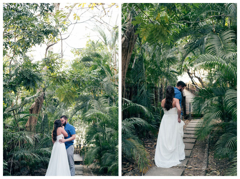 Couple kissing in a jungle pathway to the beach in Tamarindo, Costa Rica. Photographed by Kristen M. Brown, Samba to the Sea Photography.