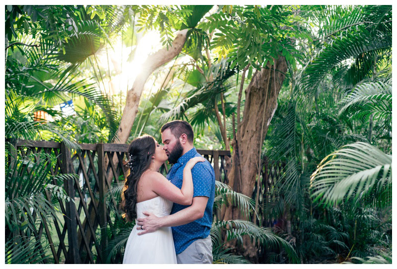 Bride and groom romantically kissing at a secret jungle pathway in Costa Rica. Photographed by Kristen M. Brown, Samba to the Sea Photography.