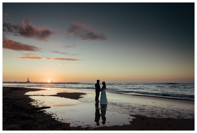 Bride and grooms's silhouettes reflecting on the the beach during sunset in Tamarindo, Costa Rica. Photographed by Kristen M. Brown, Samba to the Sea Photography.