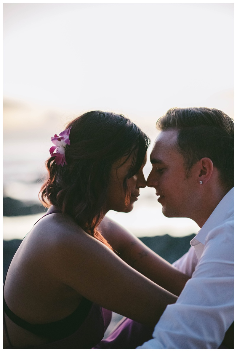 Bride and groom nose-to-nose after their elopement on the beach in Costa Rica. Photographed by Kristen M. Brown, Samba to the Sea Photography.