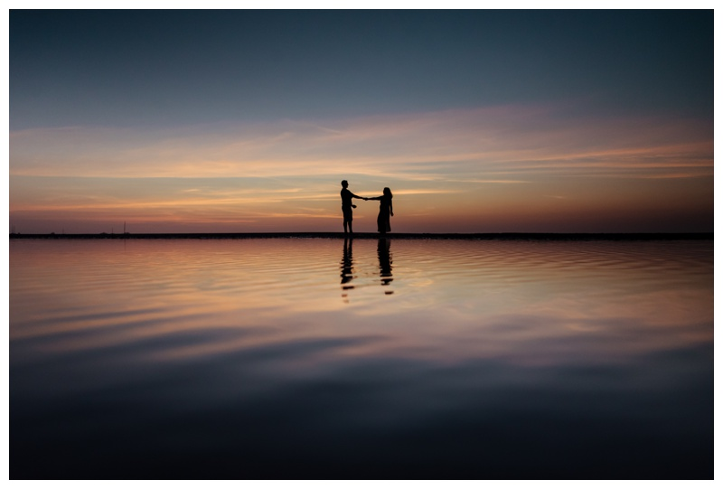 Silhouette of husband and wife during a gorgeous sunset in Tamarindo, Costa Rica. Photographed by Kristen M. Brown, Samba to the Sea Photography.