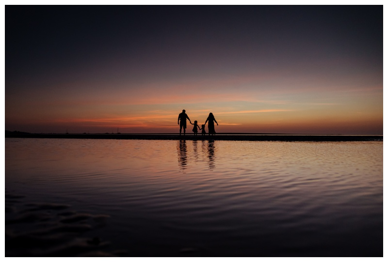 Sunset silhouette of family walking on the beach in Tamarindo, Costa Rica Photographed by Kristen M. Brown, Samba to the Sea Photography.