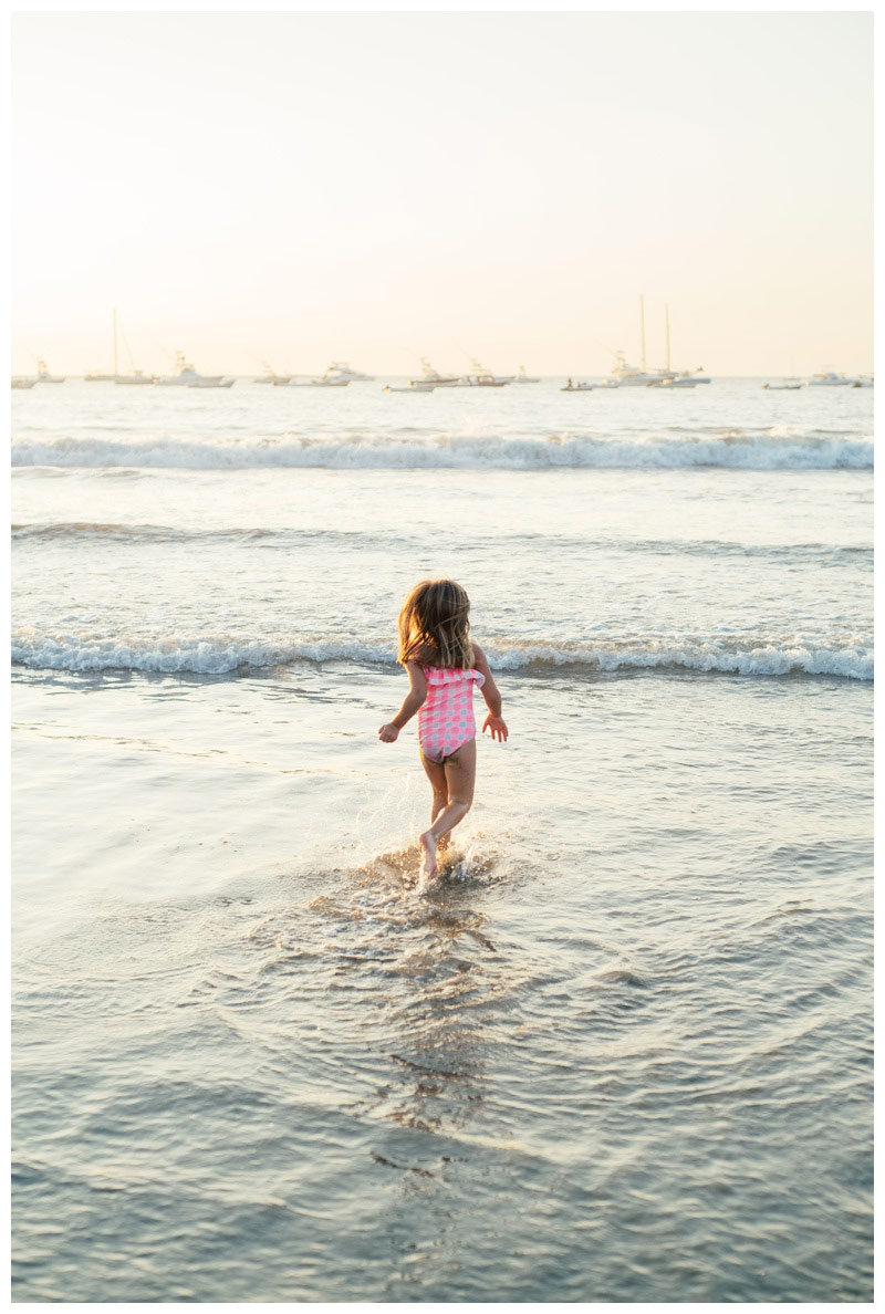 Young girl running into the ocean in Tamarindo, Costa Rica. Photographed by Kristen M. Brown, Samba to the Sea Photography.
