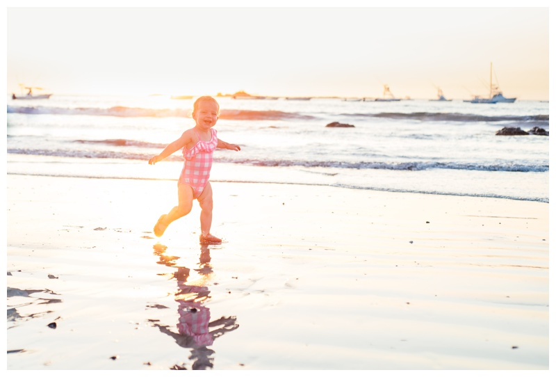 Toddler running on the beach during golden hour in Tamarindo, Costa Rica. Photographed by Kristen M. Brown, Samba to the Sea Photography.