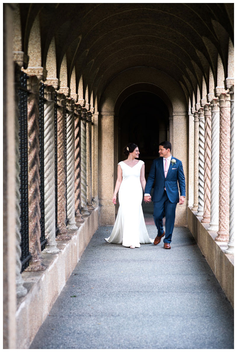 Bride and groom walking in the gardens of St. Francis monastery. Photographed by Kristen M. Brown, Samba to the Sea Photography.