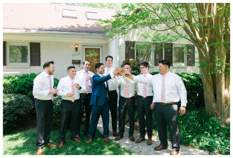 Groom and his groomsman toasting. Photographed by Kristen M. Brown, Samba to the Sea Photography.
