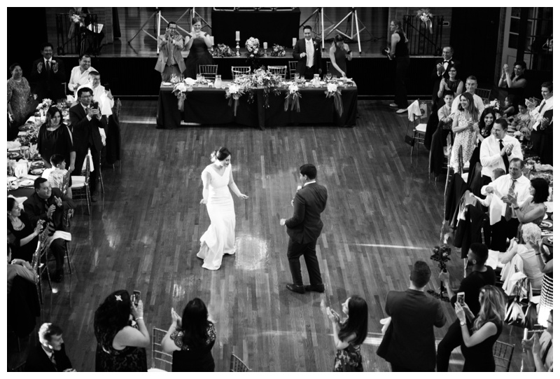 Bride and groom dancing their first dance at St. Francis Hall. Photographed by Kristen M. Brown, Samba to the Sea Photography.