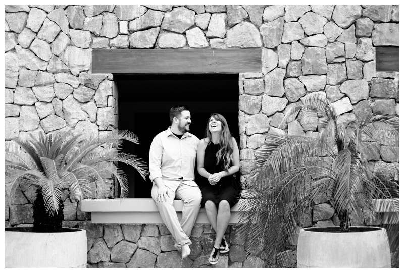 Couple laughing during engagement photos at the JW Marriott at Hacienda Pinilla. Photographed by Kristen M. Brown, Samba to the Sea Photography.