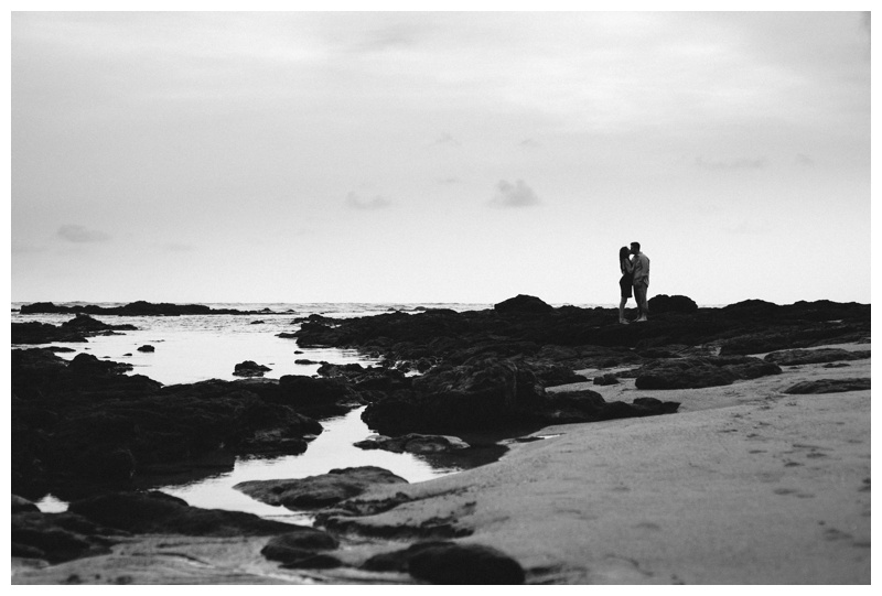 Couple kissing on the beach in Costa Rica. Photographed by Kristen M. Brown, Samba to the Sea Photography.