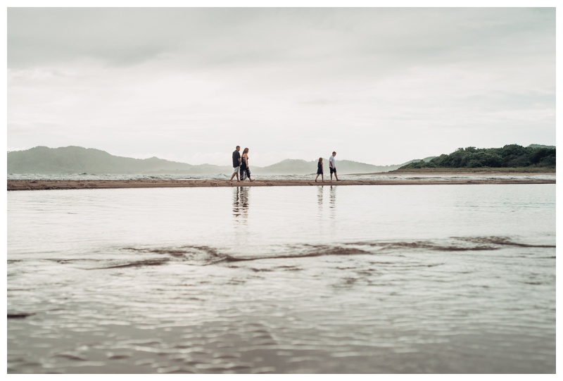 Family walking on the beach during family photos Tamarindo Costa Rica. Photographed by Kristen M. Brown, Samba to the Sea Photography.