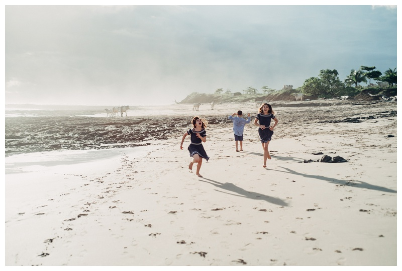 Siblings running on the beach in Playa Avellanas Costa Rica. Photographed by Kristen M. Brown, Samba to the Sea Photography.