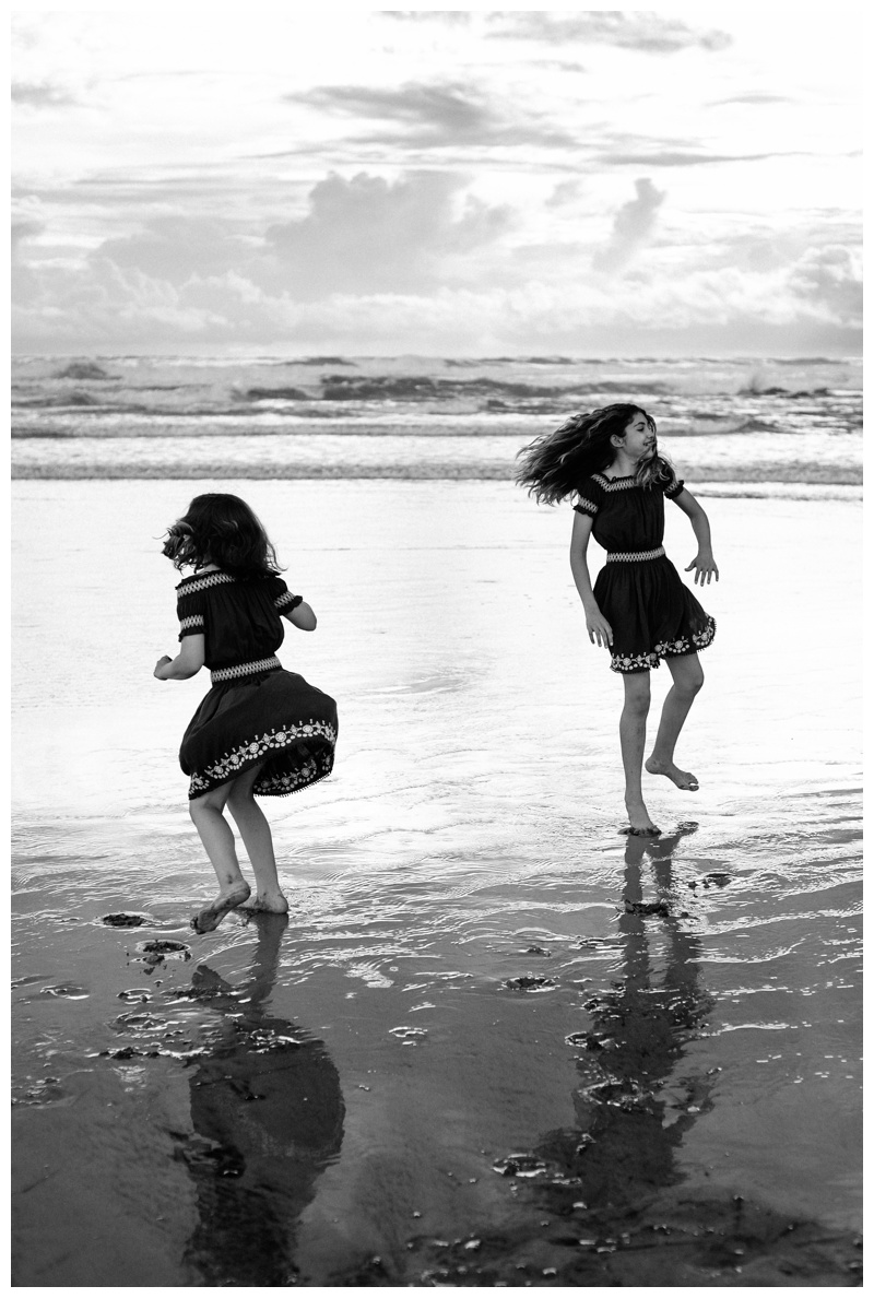 Sisters dancing on the beach in Playa Avellanas Costa Rica. Photographed by Kristen M. Brown, Samba to the Sea Photography.