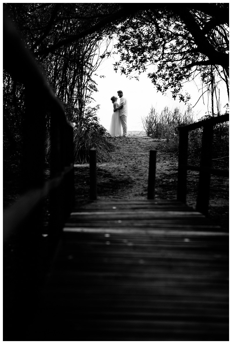 Bride and groom in a secret beach path in Tamarindo Costa Rica. Photographed by Kristen M. Brown, Samba to the Sea Photography.