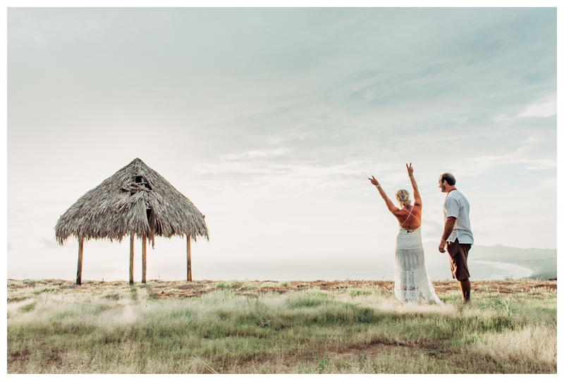 Bride and groom after their elopement with the most beautiful view of the Pacific Ocean in Costa Rica. Photographed by Kristen M. Brown, Samba to the Sea Photography.