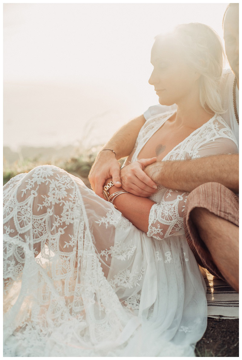 Couple embracing in the most magical afternoon light. Photographed by Kristen M. Brown, Samba to the Sea Photography.