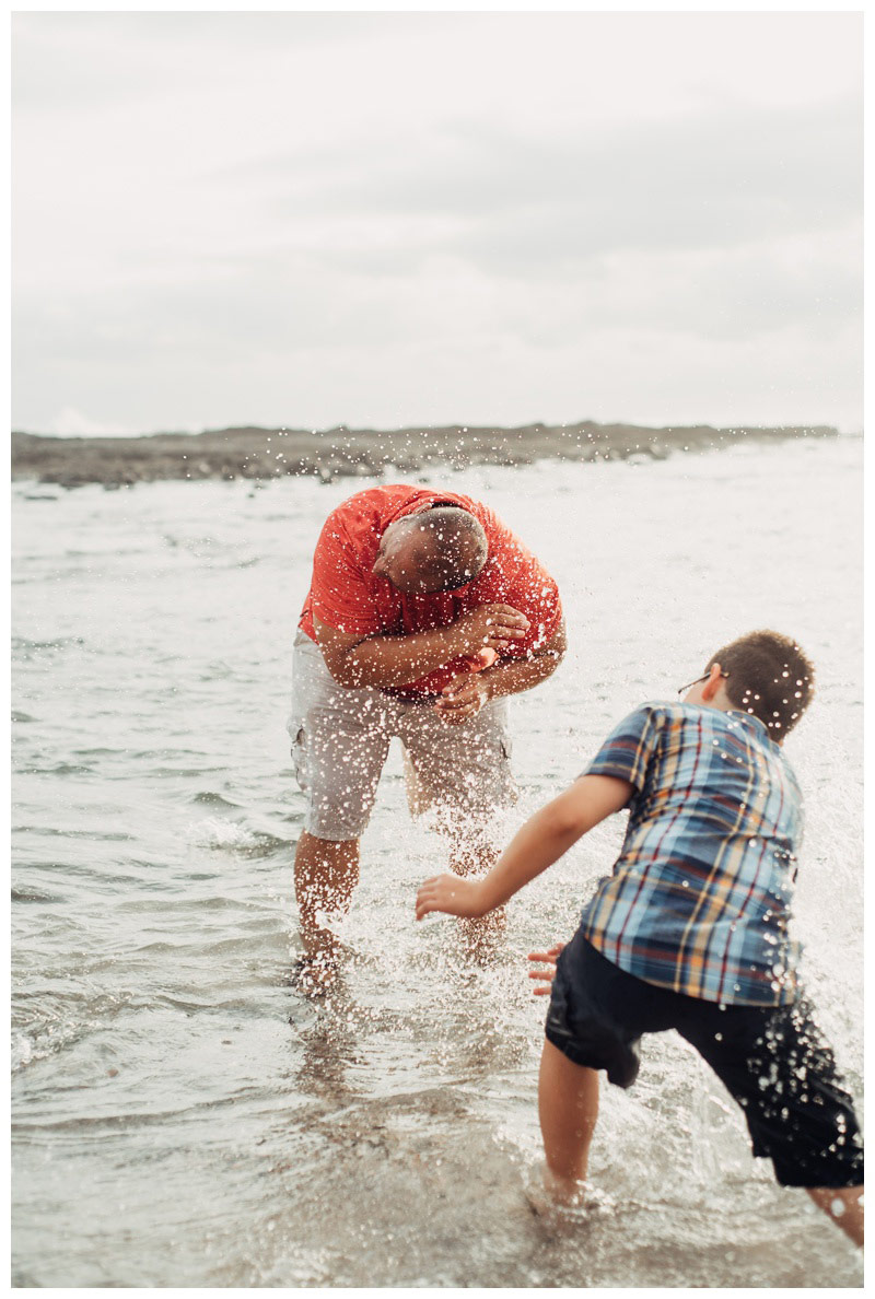 Family splashing in the ocean in Playa Langosta. Tamarindo Costa Rica Family Photography. Photographed by Kristen M. Brown, Samba to the Sea Photography.