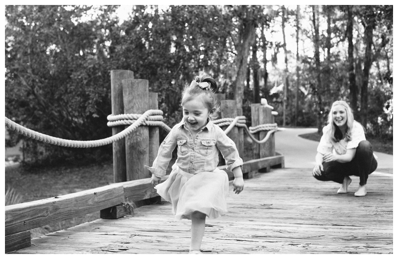 Young girl running on a golf cart bridge at The Landings in Savannah GA. Photographed by Kristen M. Brown, Samba to the Sea Photography.