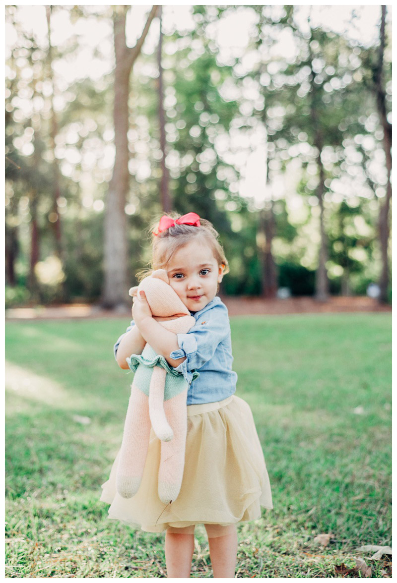 Little girl hugging her stuffed kitty cat. Photographed by Kristen M. Brown, Samba to the Sea Photography.