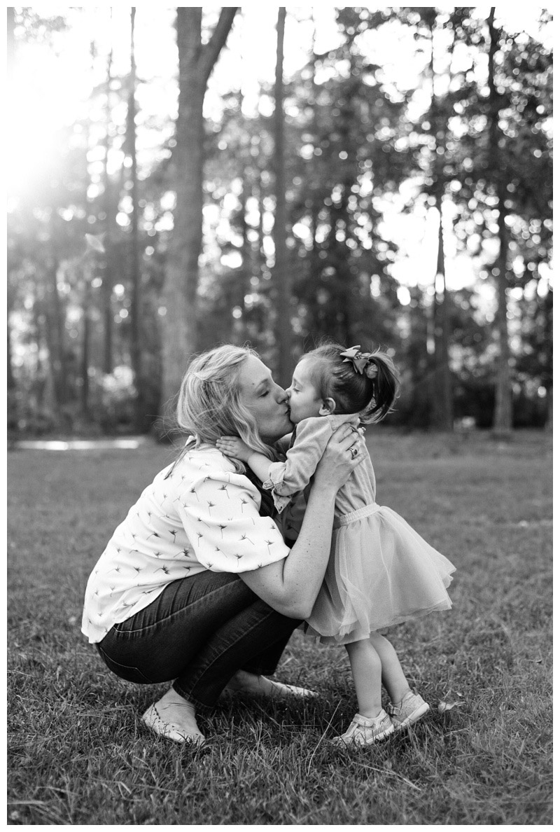 Girl kissing her mom during family photos at The Landings in Savannah. Photographed by Kristen M. Brown, Samba to the Sea Photography.