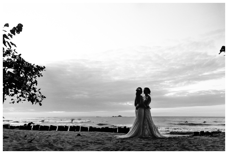 Black and white photo of brides on the beach in Tamarindo Costa Rica. Photographed by Kristen M. Brown, Samba to the Sea Photography.
