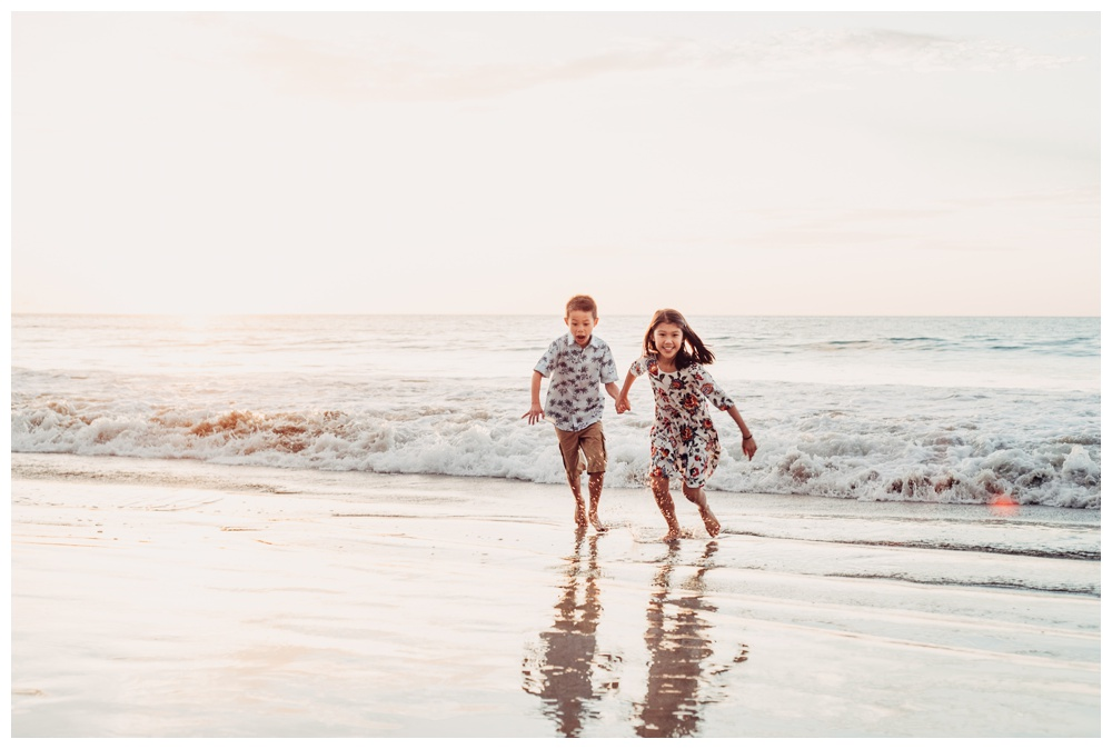Kids running on the beach in Playa Flamingo Costa Rica. Photographed by Kristen M. Brown, Samba to the Sea Photography.