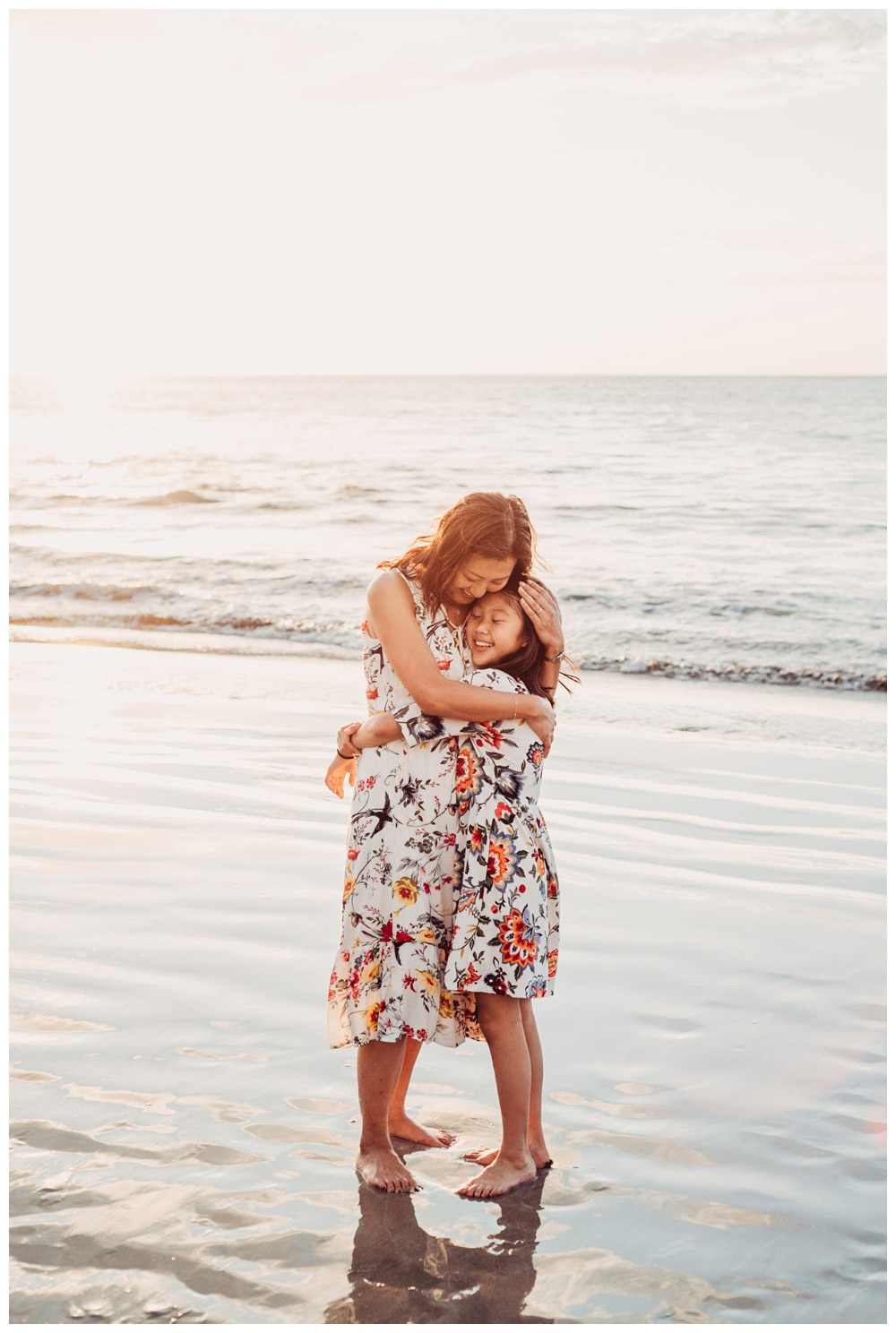 Mother and daughter hugging on the beach during family photos in Playa Flamingo Costa Rica. Photographed by Kristen M. Brown, Samba to the Sea Photography.