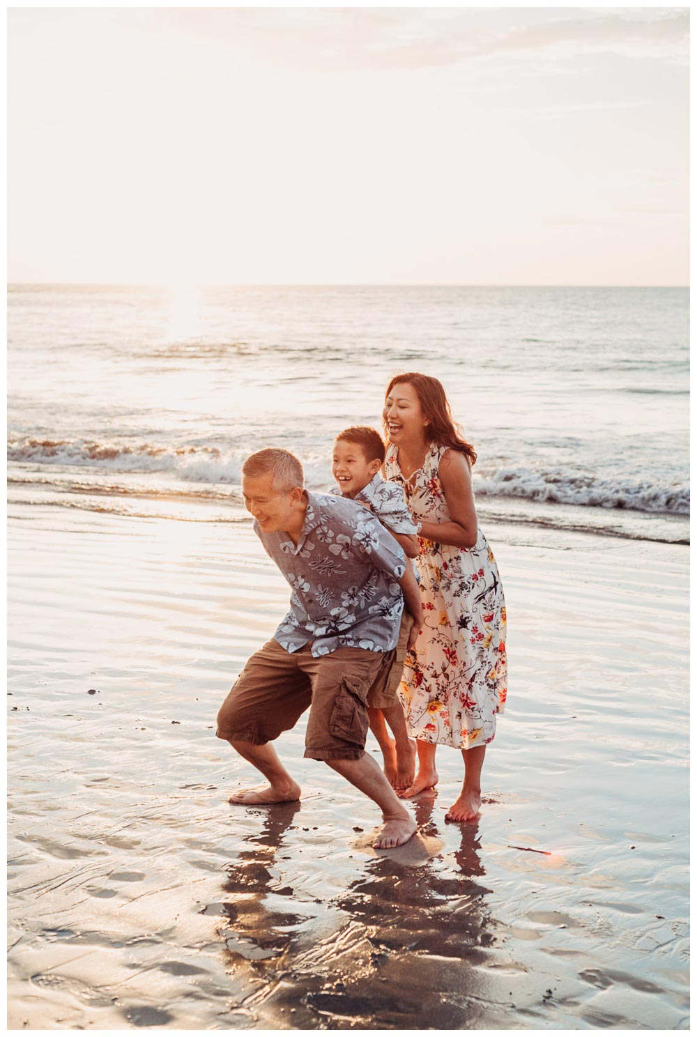 Family playing on the beach during family photos in Playa Flamingo Costa Rica. Photographed by Kristen M. Brown, Samba to the Sea Photography.