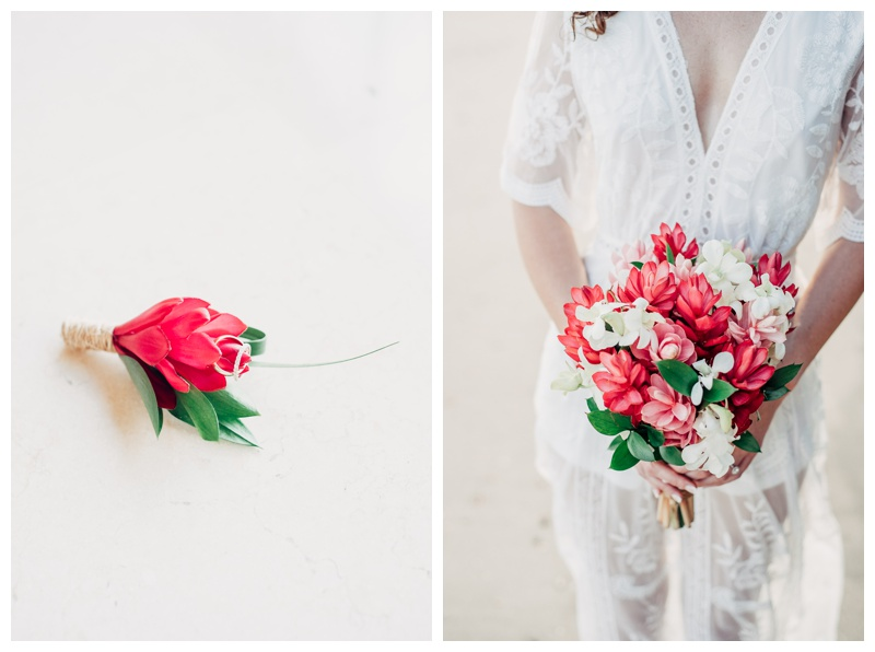 Bride holding a tropical bouquet. Magical sailboat elopement in Costa Rica. Photographed by Kristen M. Brown, Samba to the Sea Photography.