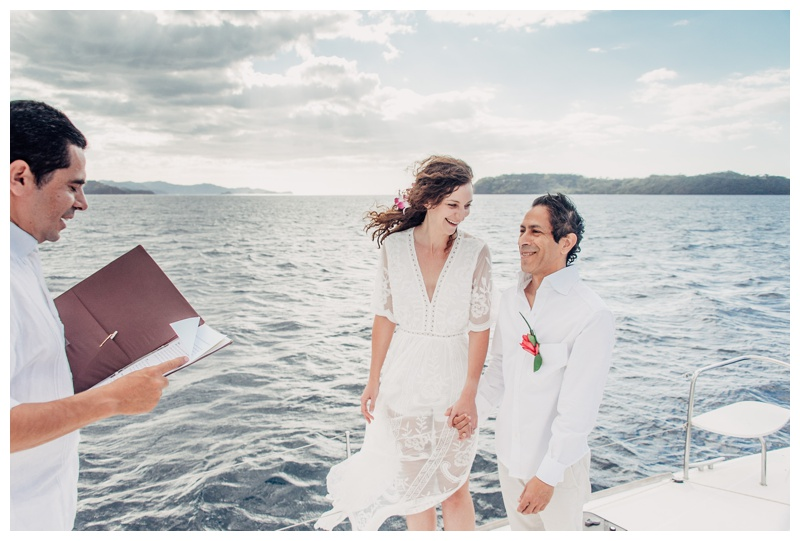 Bride and groom exchanging vows during their magical sailboat elopement in Costa Rica. Photographed by Kristen M. Brown, Samba to the Sea Photography.