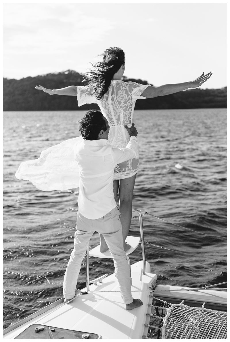 Groom holding his bride during their magical sailboat elopement in Costa Rica. Photographed by Kristen M. Brown, Samba to the Sea Photography.