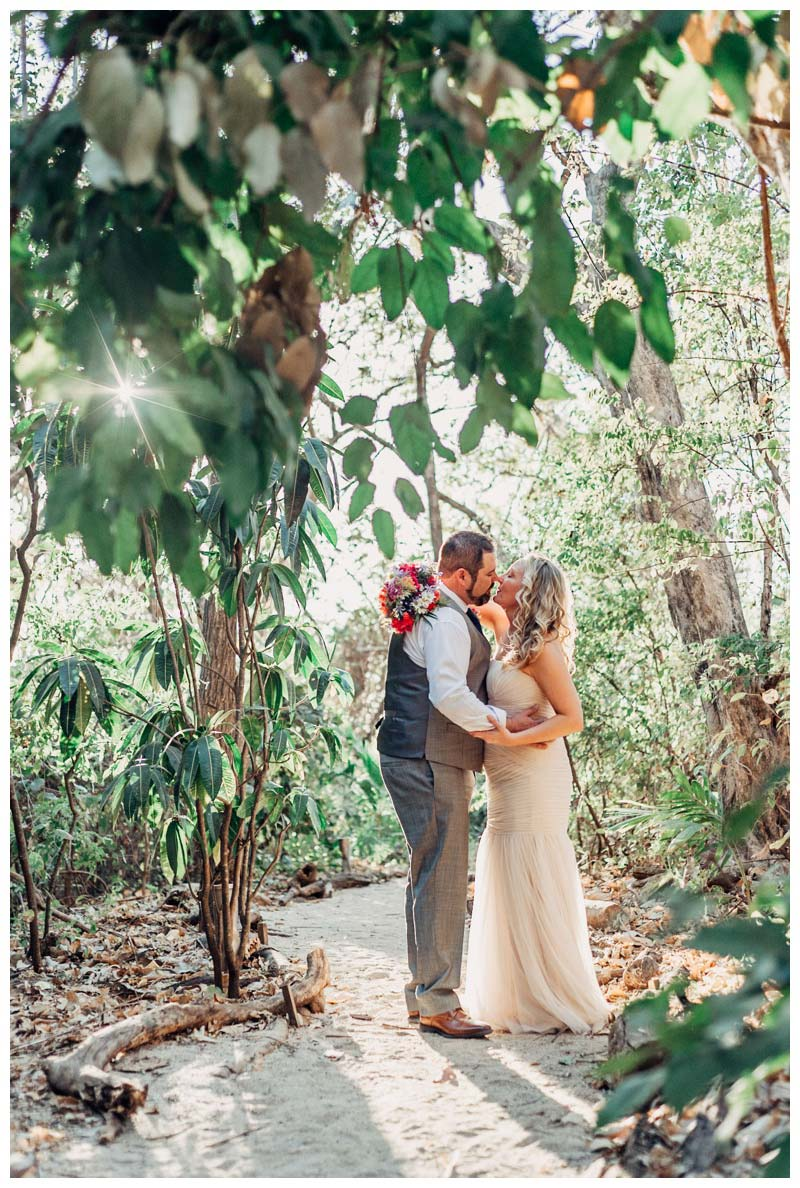 Bride and groom kissing in a hidden beach path at Cala Luna Boutique Hotel in Playa Langosta Costa Rica. Photographed by Kristen M. Brown, Samba to the Sea Photography.Bride and groom on the beach during sunset in Tamarindo Costa Rica. Photographed by Kristen M. Brown, Samba to the Sea Photography.