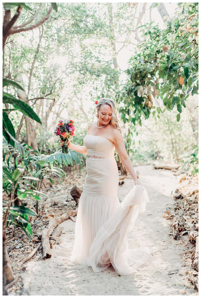 Bridal portrait in a hidden beach path at Cala Luna Boutique Hotel in Playa Langosta Costa Rica. Photographed by Kristen M. Brown, Samba to the Sea Photography.Bride and groom on the beach during sunset in Tamarindo Costa Rica. Photographed by Kristen M. Brown, Samba to the Sea Photography.