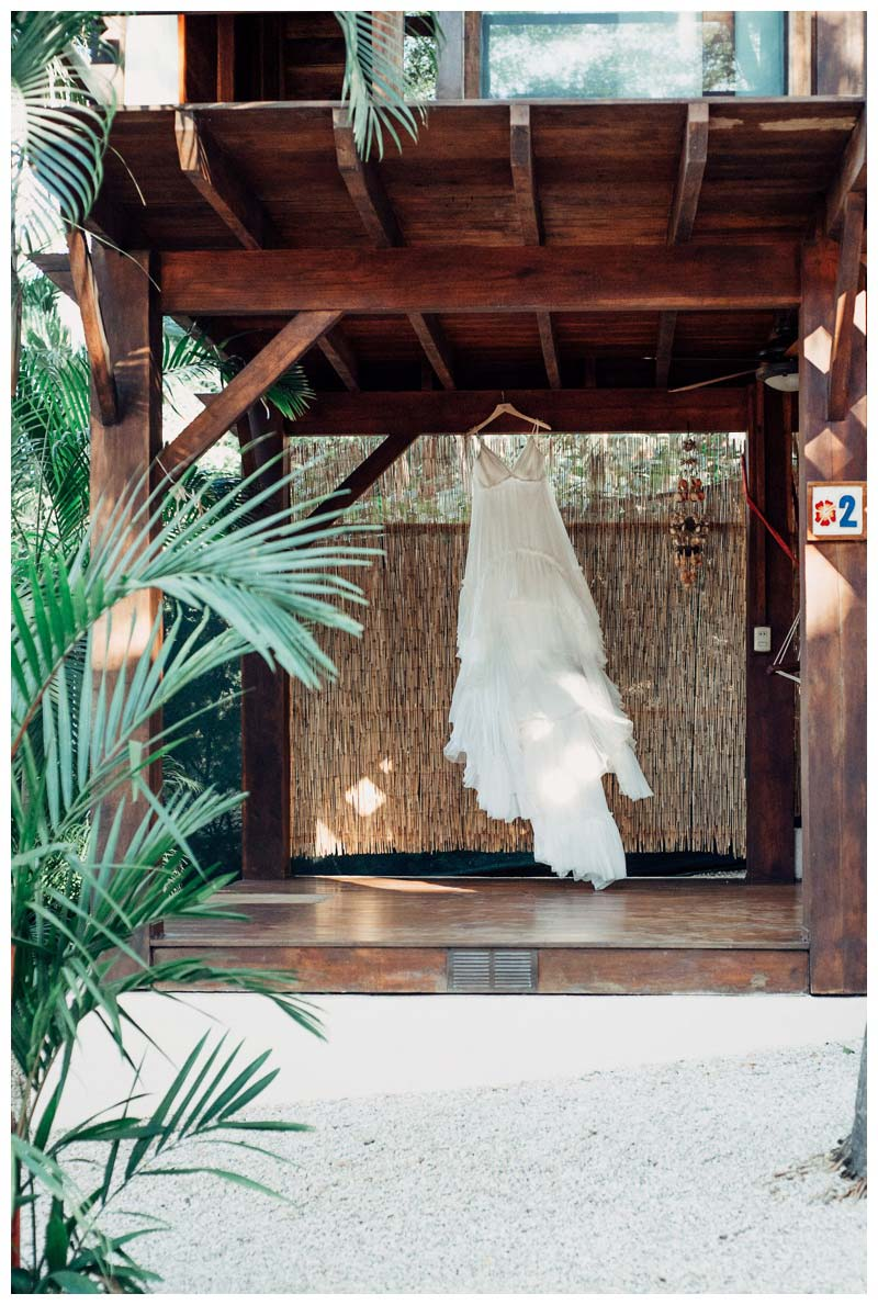 Boho wedding dress flowing in the wind at Beach Bungalows in Tamarindo Costa Rica. Photographed by Kristen M. Brown, Samba to the Sea Photography.