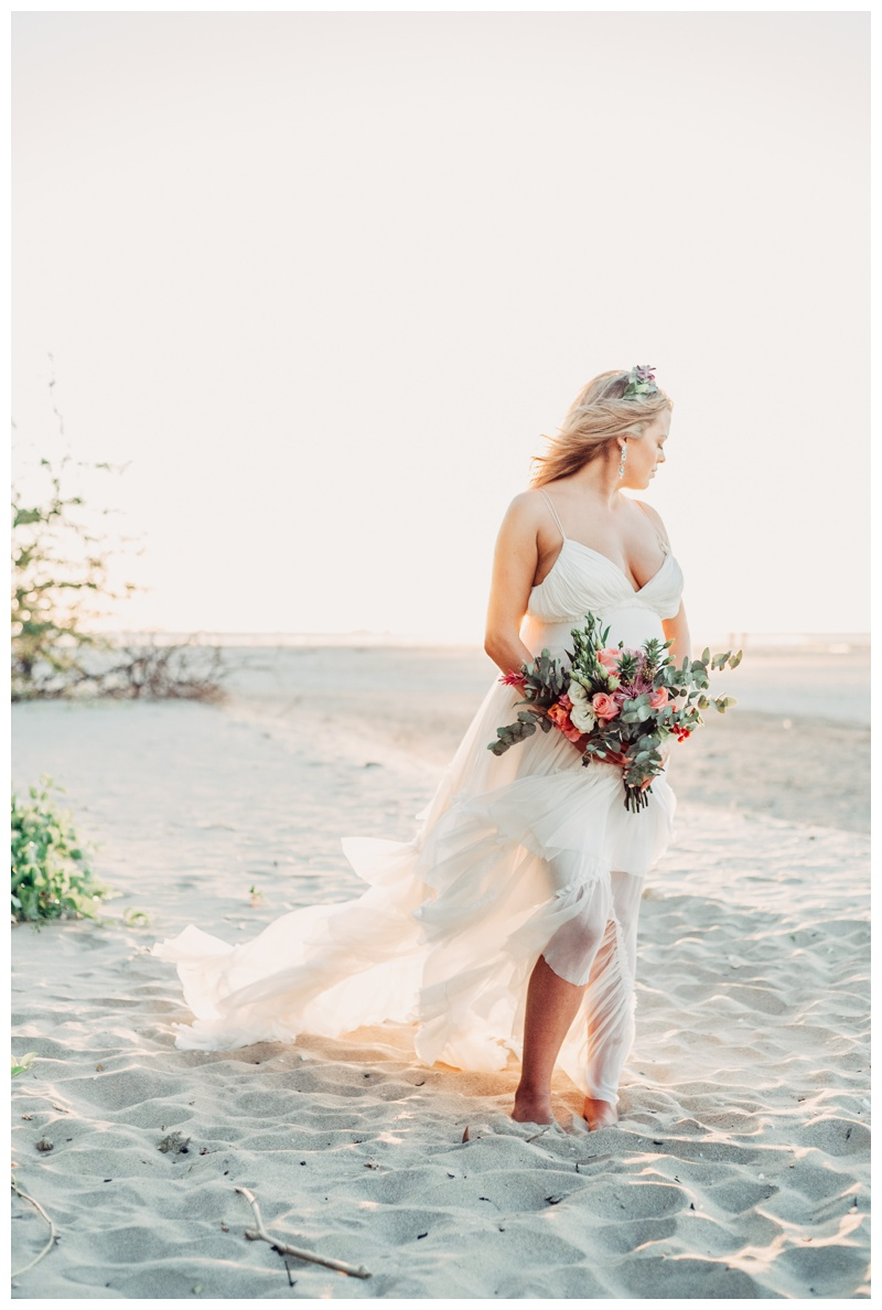 Bridal portrait on the beach in Tamarindo Costa Rica. Boho wedding dress by Cristalle. Photographed by Kristen M. Brown, Samba to the Sea Photography.