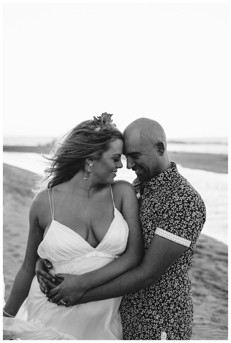 Bride and groom embracing on the beach in Tamarindo Costa Rica. Photographed by Kristen M. Brown, Samba to the Sea Photography.