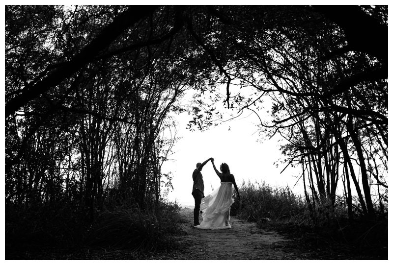 Bride and groom in a hidden beach path in Tamarindo Costa Rica. Photographed by Kristen M. Brown, Samba to the Sea Photography.